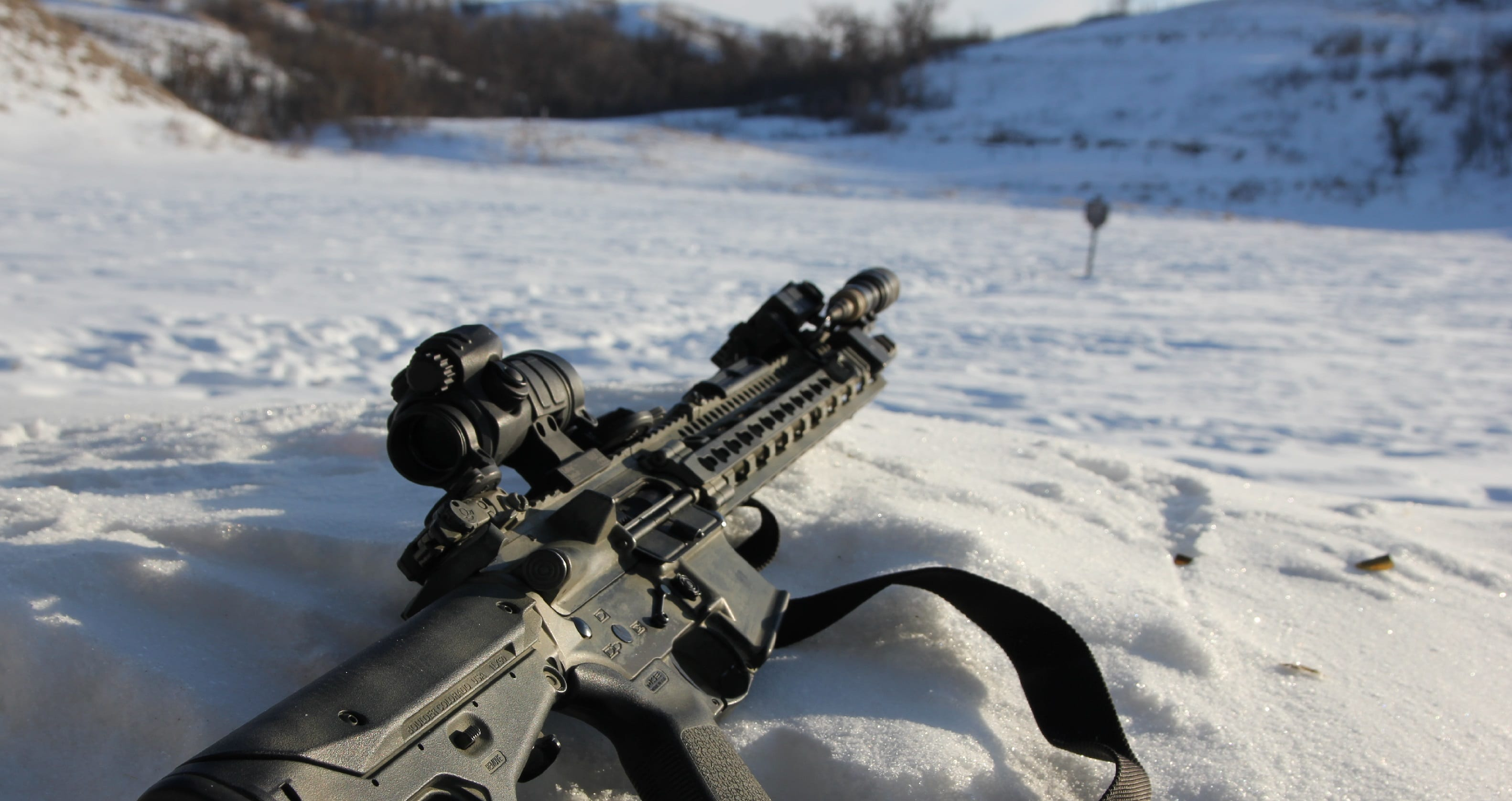 Aimpoint PRO in snow on daniel defense m4v11