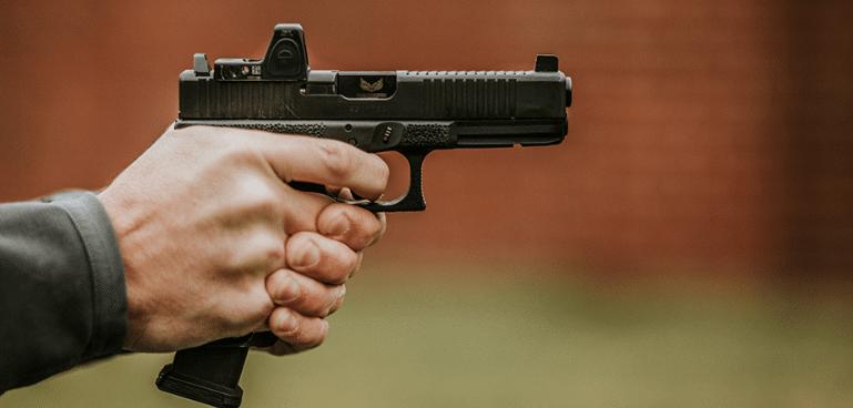 Low bore axis handgun with trijicon rmr