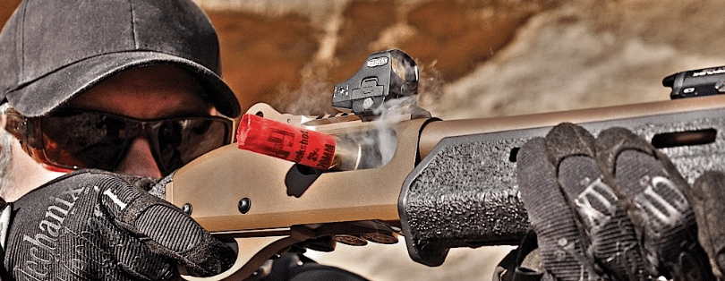 Remington 870 with micro red dot sight firing