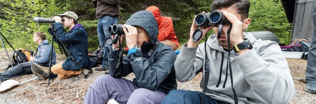 Hiking trip everyone using binoculars