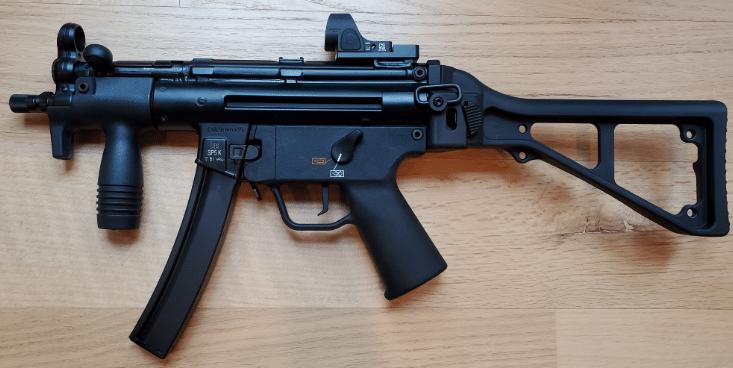 HK sp5k with trijicon SRO