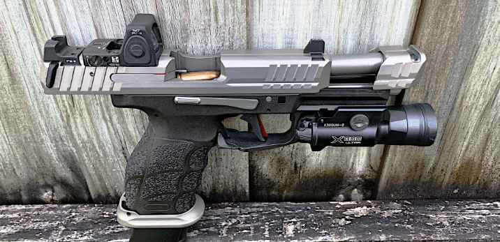 stainless steel VP9 with surefire x300u and trijicon rmr