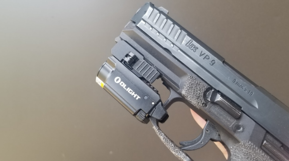 Olight BALDR MINI on HK VP9 9mm pistol