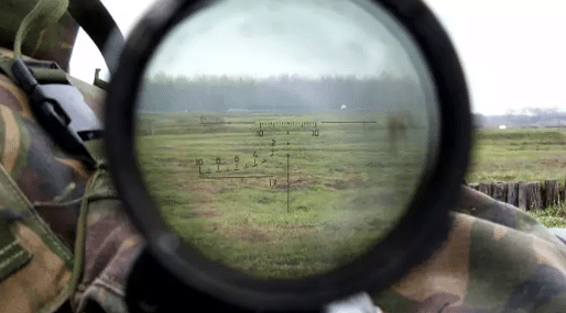rifle scope lens and aiming reticle