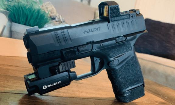 springfield hellcat pistol with olight baldr mini light