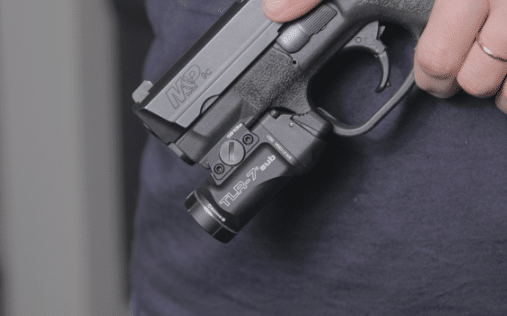 streamlight tlr 7 sub held in hand